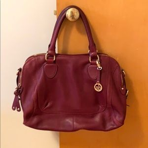 Maroon purse with gold accents